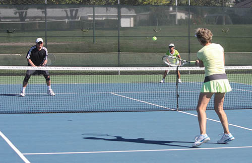 Mixed doubles on tennis court