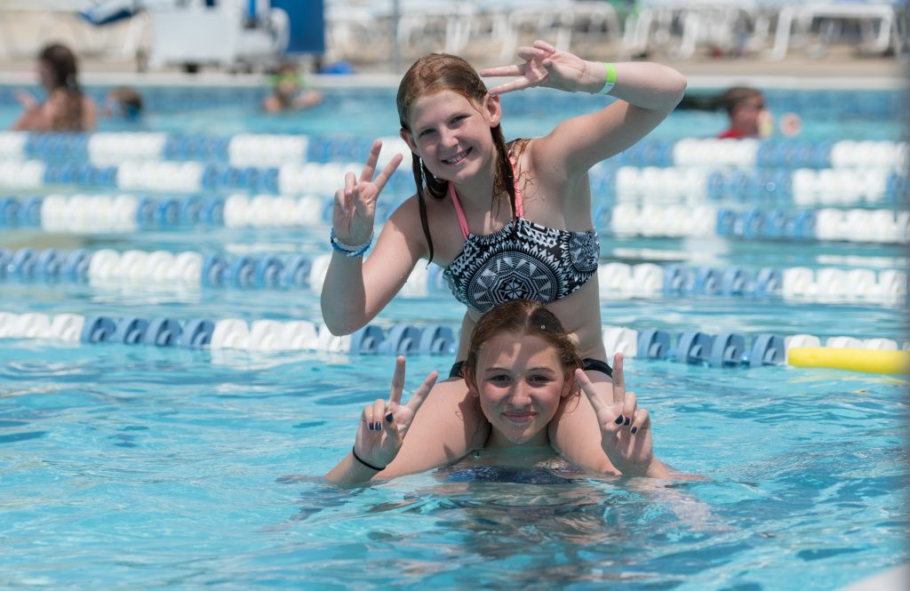 Girls playing in an outdoor pool